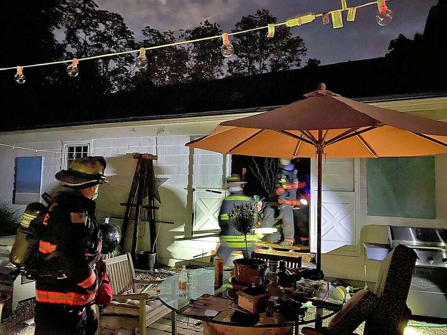 Firefighters quickly extinguished a fire that was found in the wall of a Turkey Hill Lane house Tuesday night on June 2, 2020. The cause of the fire is under investigation. Photo: Westport Fire Department Photo