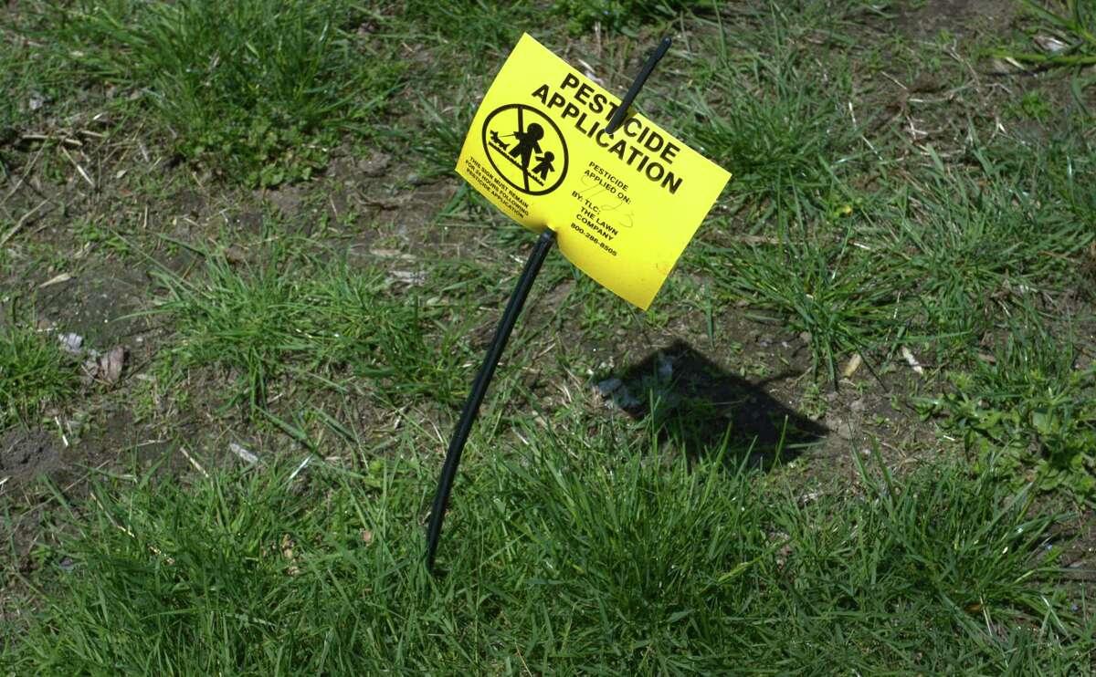A pesticide warning sign in Norwalk.