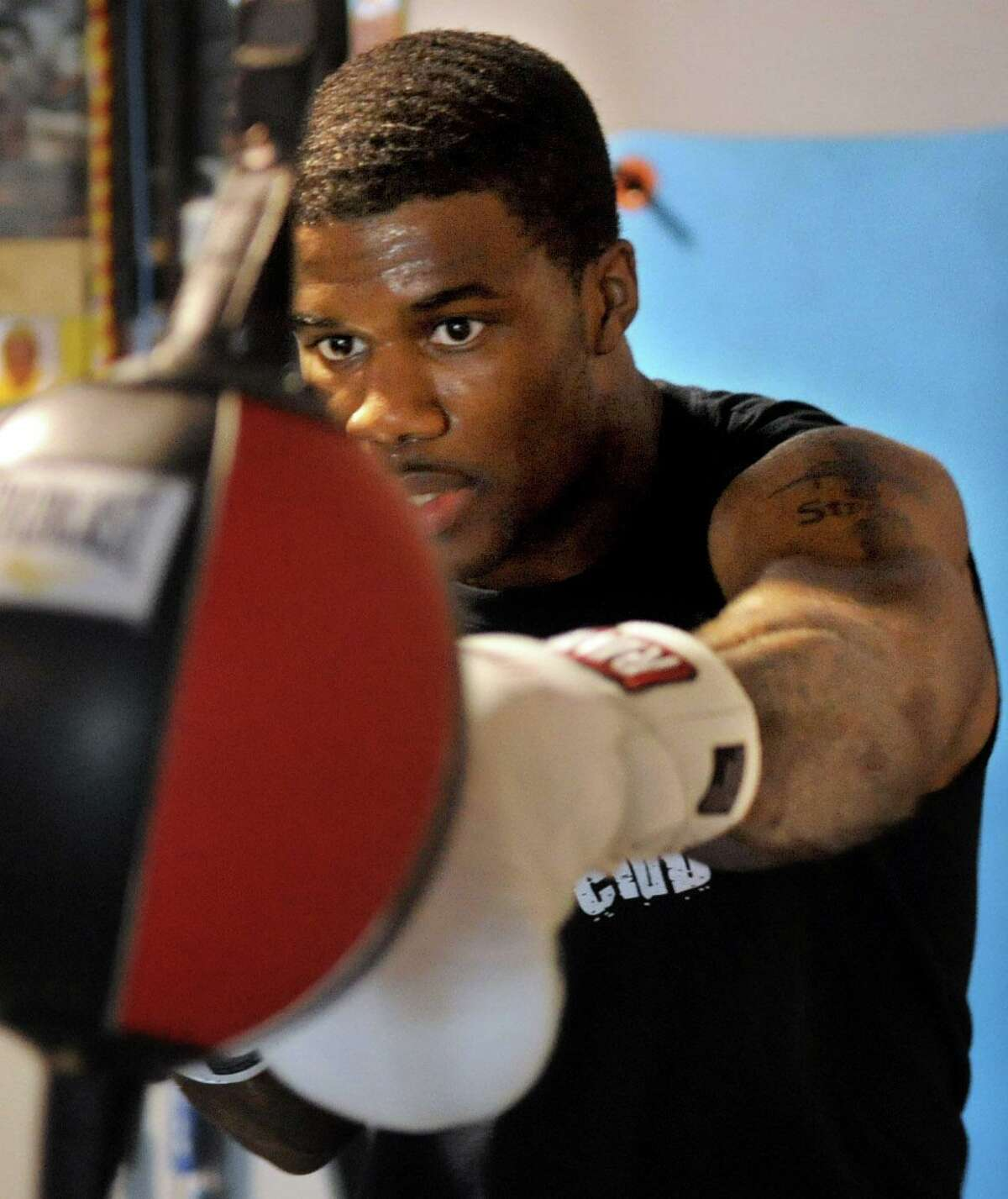 Chordale Booker trains at Revolution Fitness in Stamford on Thursday, July 5, 2012.