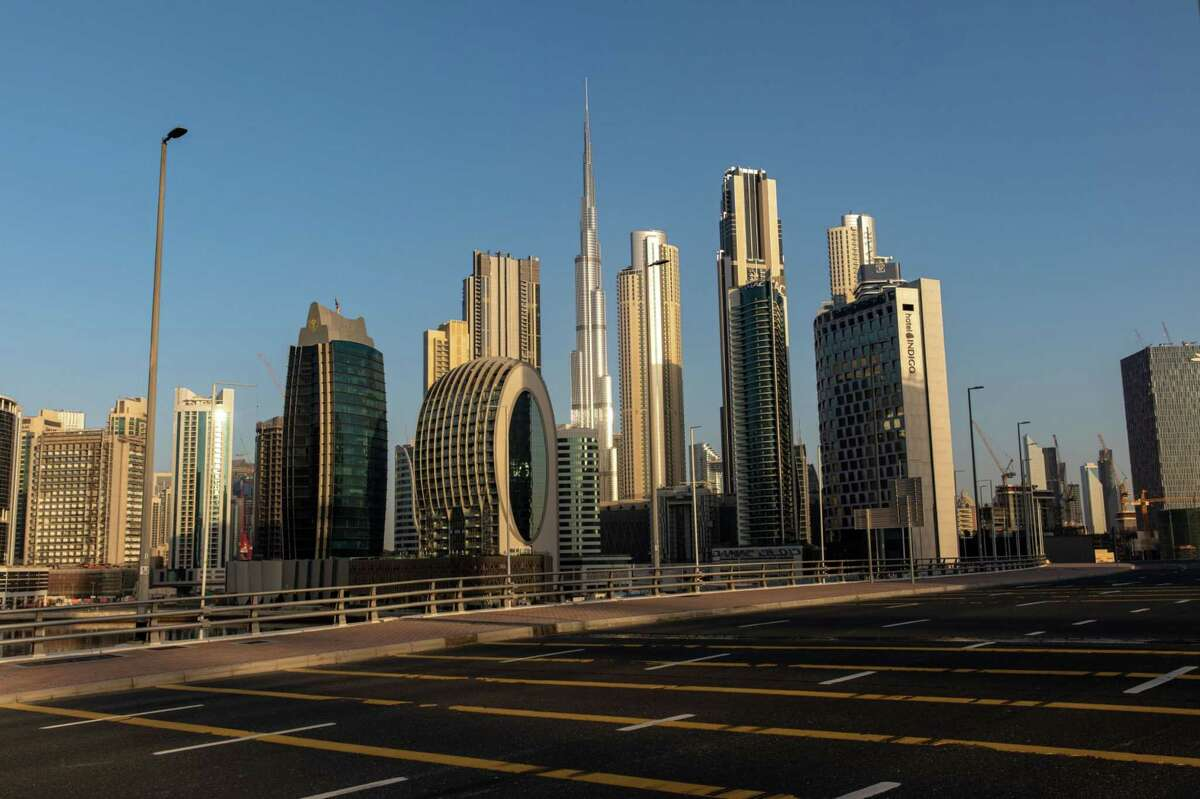 An empty highway leads past the Burj Khalifa skyscraper (center) and other office buildings on the city skyline during the coronavirus lockdown in Dubai, United Arab Emirates, on April 24, 2020.