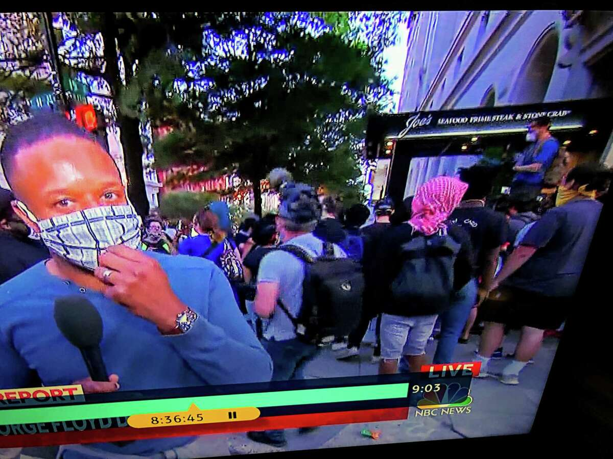 A screen shot of NBC coverage of a Washington, D.C. protest in front of Joe's Seafood Prime Steak & Stone Crab.