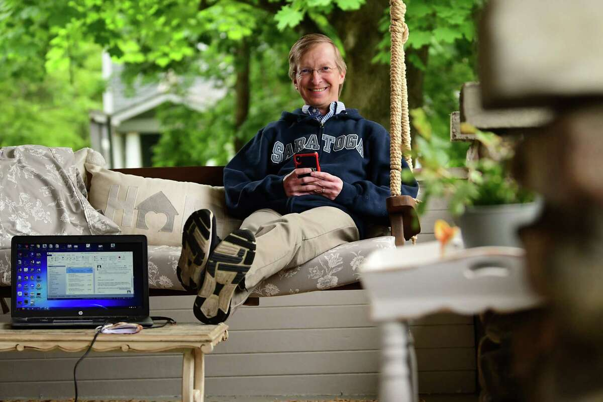 Todd Shimkus, president of the Saratoga County Chamber of Commerce, is seen on his porch working from home on Tuesday, June 2, 2020 in Saratoga Springs, N.Y. (Lori Van Buren/Times Union)