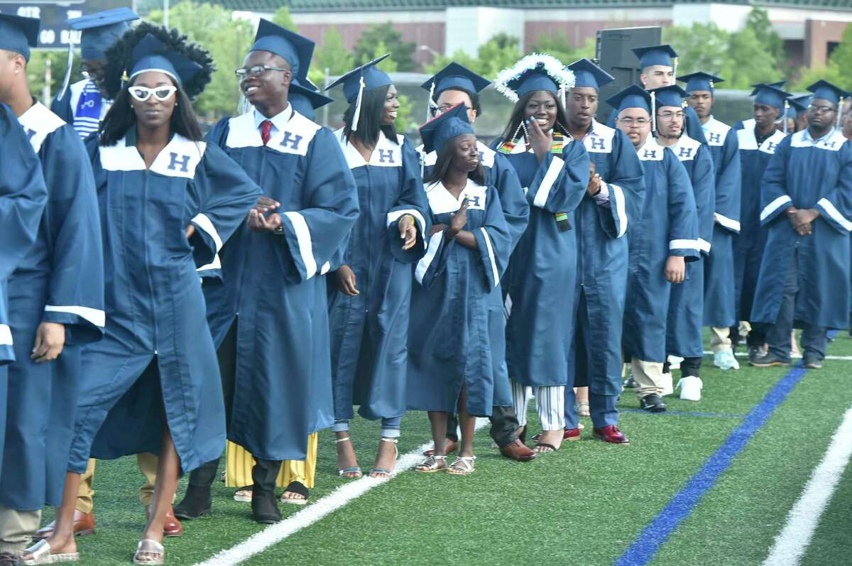 In This file photo, in New Haven, Conn. June 14, 2019, Hillhouse High Scool 160th Commencement Exercises at Bowen Field in New Haven.