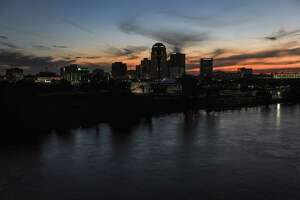 The sun sets on downtown Shreveport, La., on May 1, 2020.