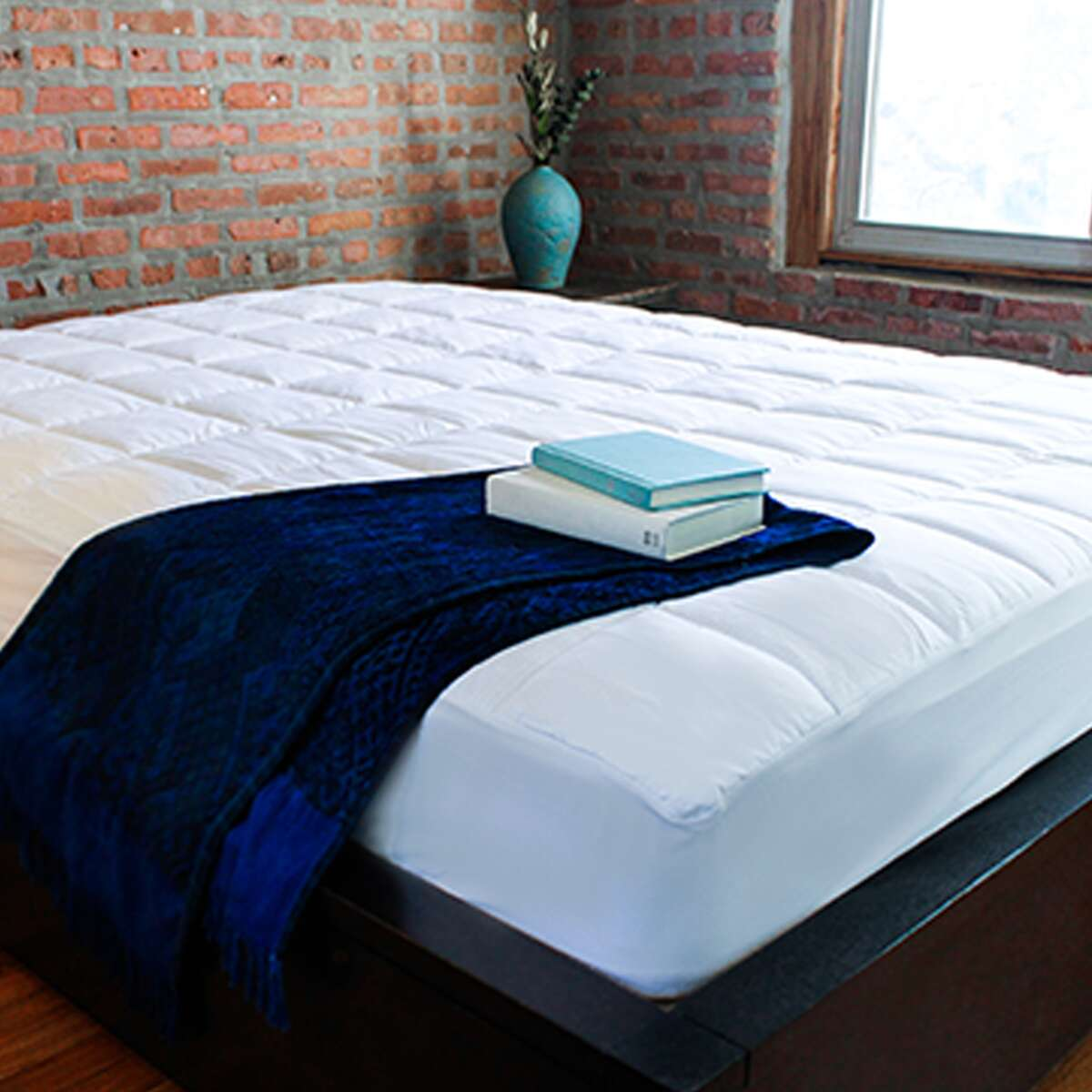 Best Overall Cooling Mattress Pad Nacreous Mattress Pad SlumberCloud slumbercloud.com $139.00 SlumberCloud offers a traditional style mattress pad that goes on your mattress like a fitted sheet, but also uses Outlast technology to keep you cool. Outlast absorbs heat when you get overheated and releases it when you are too cold, preventing night sweats in the first place. Using a mix of Outlast viscose and cotton fabric on the top, it has a soft feel while the pad is made of Lyocell to wick away moisture for extra cooling. We love that this style comes in multiple colors, too.