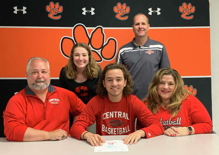 Graduated Edwardsville High School senior Carson Philipps, seated center, will play basketball at Central College in Iowa. He is joined by his family and AAU coach Ryan Cox. Photo: Matt Kamp|The Intelligencer