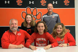 Graduated Edwardsville High School senior Carson Philipps, seated center, will play basketball at Central College in Iowa. He is joined by his family and AAU coach Ryan Cox.