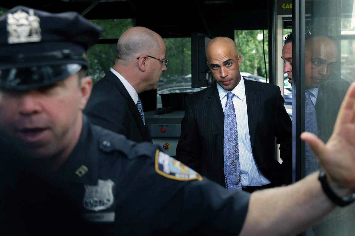 FILE - In this Sept. 21, 2015, file photo, James Blake, third from left, arrives at City Hall in New York. Blake says he never suspected the large man running toward him was a plainclothes New York City policeman. In the wake of George Floyd's death in Minneapolis, former tennis star James Blake says it's sad to see the type of policing that is still going on in America. Blake, who is black, was mistakenly identified as a suspect in a credit card fraud scheme in 2015, when an undercover New York City officer threw him to the sidewalk and handcuffed him. The experience intensified Blake's reaction to video of Floyd's death shortly after being detained by Minneapolis police last week. (AP Photo/Seth Wenig, File)