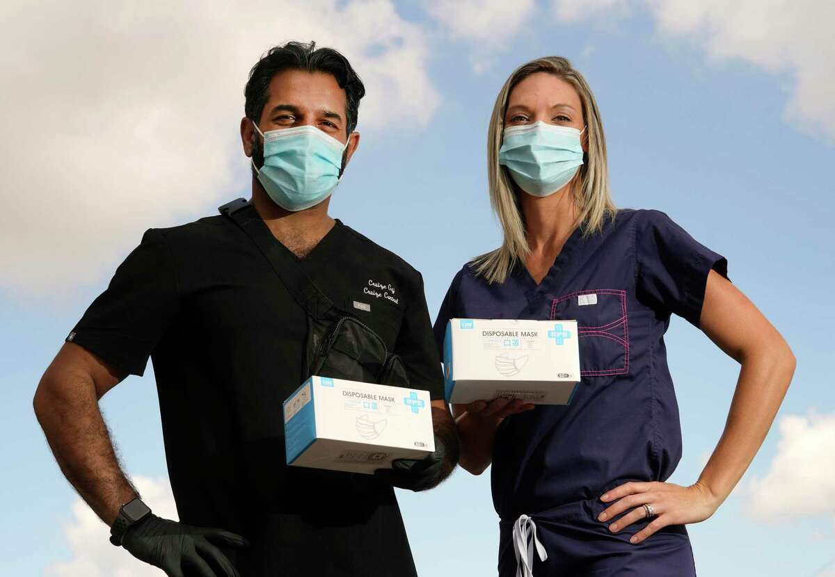 Cruize Gaj, left, and Dana Herrera, right, with Prodigy Healthcare Management are shown amid the Covid-19 pandemic Wednesday, May 27, 2020, in Houston.
