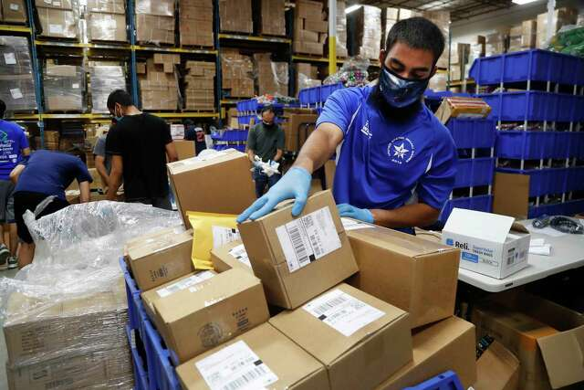 Ammar Dukka packs orders to be shipped out at Ionized LLC, a Sugar Land glow stick manufacturer that is now importing PPE from China for Harris County, on Tuesday, May 26, 2020 in Sugar Land.