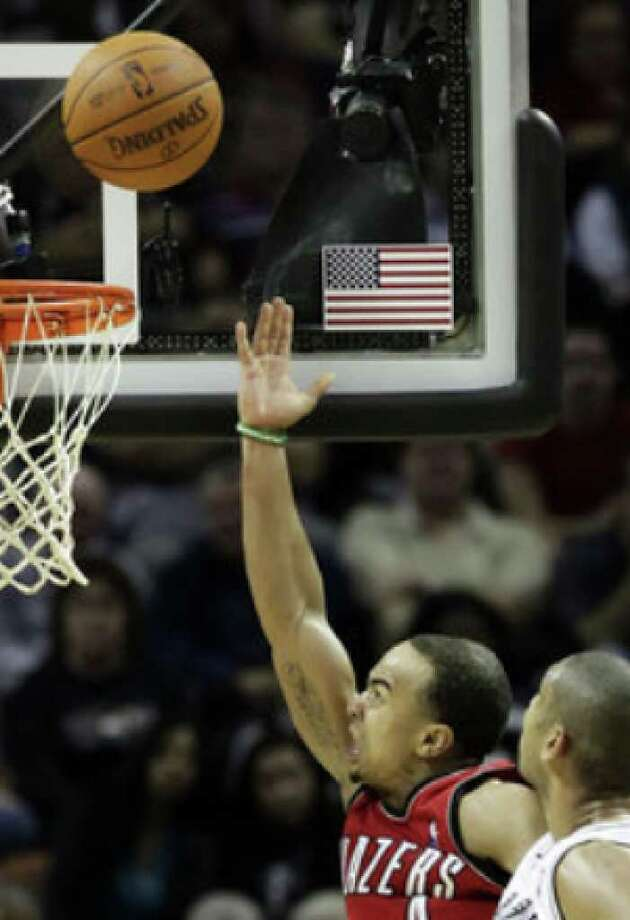 Portland's Jerryd Bayless gets past the Spurs' Tim Duncan for a layup in the second half. Bayless, starting for the injured Brandon Roy, scored a game-high 31 points Wednesday in leading the Trail Blazers to a victory.