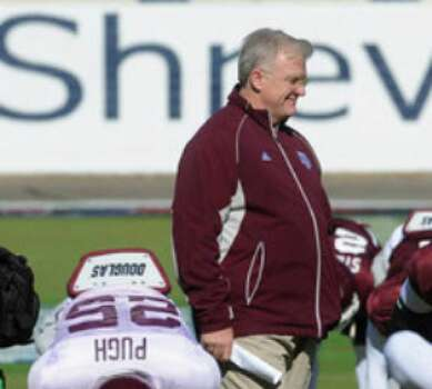 Texas A&M coach Mike Sherman watches his team practice Friday at Independence Stadium in Shreveport, La., in preparation for Georgia.