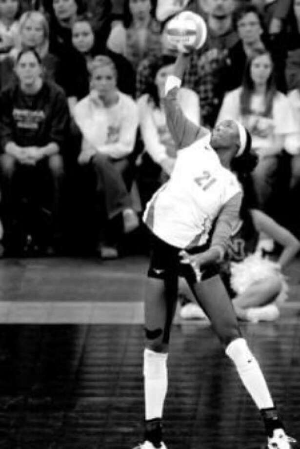 UT's Destinee Hooker, delivering a jump serve in the NCAA region final volleyball match, shared the Express-News Sportswoman of the Year honor with her sister in 2005.