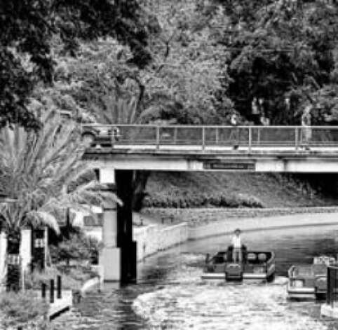 A barge makes its way along the Museum Reach section of the San Antonio River.