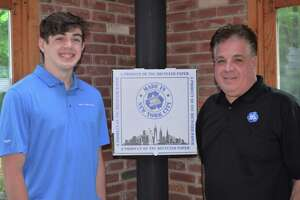 New Fairfield High School graduate and PSI Chapter scholarship recipient Michael Altobelli, left, with his father, Mike Altobelli, right.