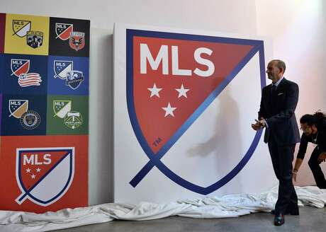 (FILES) In this file photo taken on September 18, 2014 Major League Soccer (MLS) commissioner Don Garber unveils the MLS logo during an event in New York on September. - Major League Soccer said May 28, 2020 teams can now hold outdoor training sessions with groups of up to six players as the sport gradually moves towards a return from the coronavirus shutdown. A league statement said teams were now free to conduct small-group training sessions as long as they did not conflict with local public health regulations. (Photo by Jewel SAMAD / AFP)