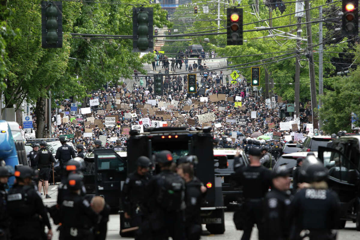 People gather to protest over the death of George Floyd, an unarmed African-American man who died in police custody in Minneapolis on May 25, outside the Seattle Police Department's East Precinct in Seattle, Washington on June 2, 2020. - Protesters defied curfews across the United States on June 2 as leaders scrambled to stem anger over police racism while President Donald Trump rejected criticism over his use of force to break up a peaceful rally. (Photo by Jason Redmond / AFP) (Photo by JASON REDMOND/AFP via Getty Images)