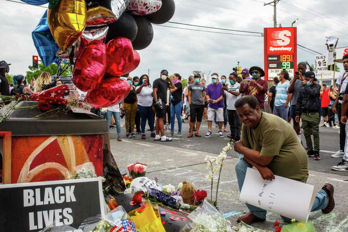 A man prays in front of a makeshift memorial for George Floyd. What happened in Minneapolis was a gross failure of individual duty, but also a failure of leadership.