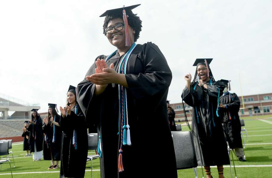 Regan Booth and classmates react after Superintendent Shannon Allen congratulates them on their official graduation at the BISD Early College High School commencement ceremony at Memorial Stadium Wednesday morning. The event is the first of several graduation ceremonies that BISD will hold this week. Beaumont United and West Brook's commencements will be held Thursday and Friday, each with a morning and evening event to accoomodate social distancing due to the class sizes. ECHS's 2020 graduationing class was its first enrollees when the school was created. Photo taken Wednesday, June 3, 2020 Kim Brent/The Enterprise Photo: Kim Brent/The Enterprise