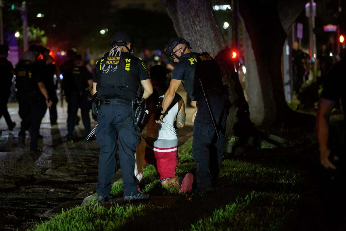 A man is detained Tuesday, June 2, 2020, in downtown Houston during the fifth night of protests across the nation sparked by the death of former Houston resident George Floyd.
