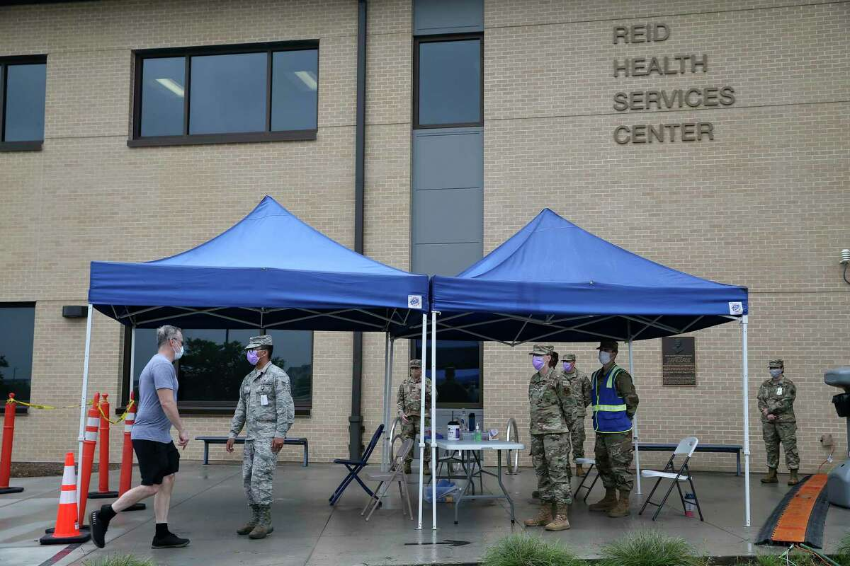 Incoming traffic is screened at the entranced to the Reid Health Services Center at Joint Base San Antonio-Lackland, Wednesday, April 22, 2020. Shelters were set up outside the facility to accommodate coronavirus patients should the need arise.