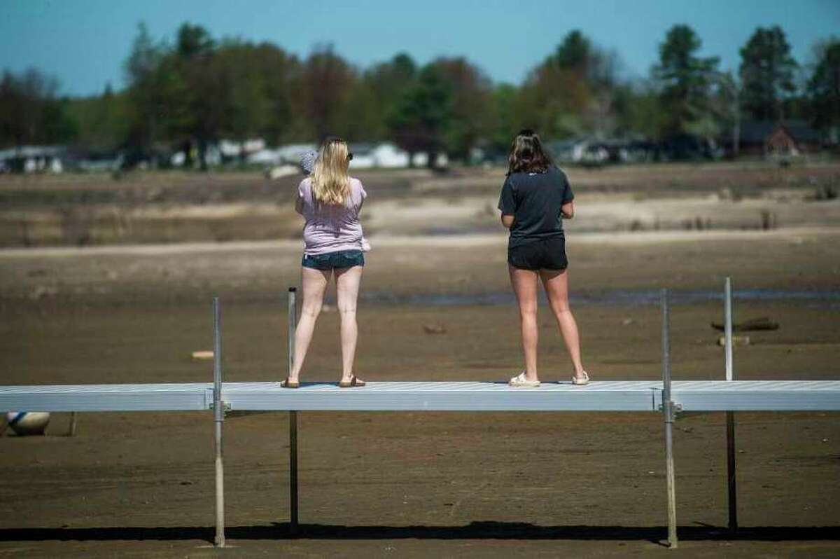 Wixom Lake is nearly empty May 21, after devastating flooding and dam failures. When the bottomlands of a lake are exposed, who owns that land can come into question. (File Photo/Midland Daily News)