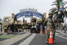 A member of the National Guard stands in front of the Santa Monica Pier building Monday, June 1, 2020, in Santa Monica, Calif., a day after unrest and protests over the death of George Floyd, a black man who was in police custody in Minneapolis. Floyd died after being restrained by Minneapolis police officers on May 25. (AP Photo/Marcio Jose Sanchez)