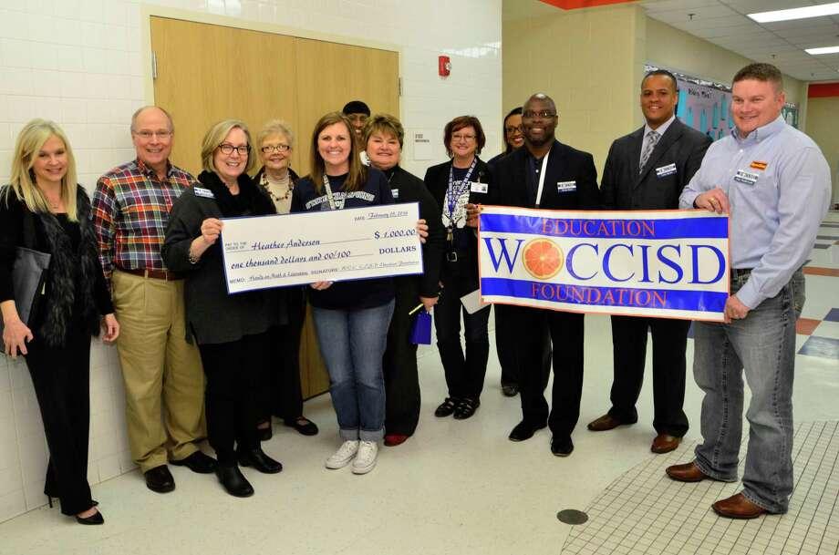 West Orange - Cove CISD  Board of Directors presenting a grant to West Orange - Stark Elementary second grade teacher Heather Anderson