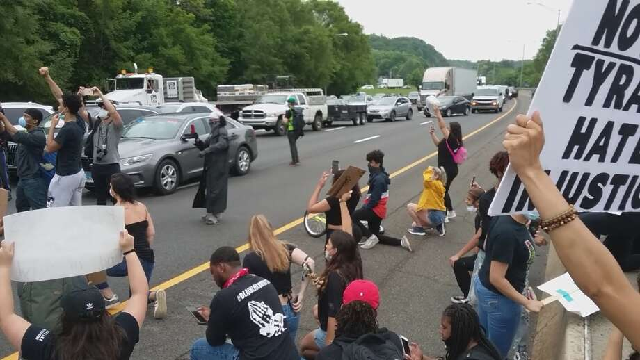 Protesters at exit 5 on I-84 in Danbury on June 3. Photo: Christian Abraham