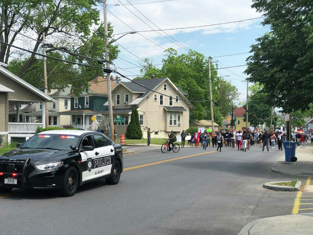 Marchers head up Whitehall Road in Albany on Wednesday. It is the latest demonstration in the city to draw attention to police brutality.