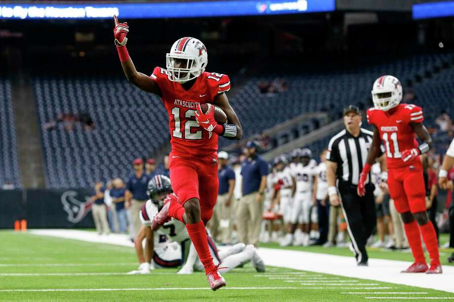 Atascocita Eagles Keith Wheeler (12) celebrates on the way to a touchdown during the first half of the high school football playoff game between the Tompkins Falcons and the Atascocita Eagles at NRG Stadium in Houston, TX on Saturday, November 30, 2019. The Eagles lead the Falcons 35-3 at halftime. Photo: Tim Warner, Houston Chronicle / Contributor / ©Houston Chronicle