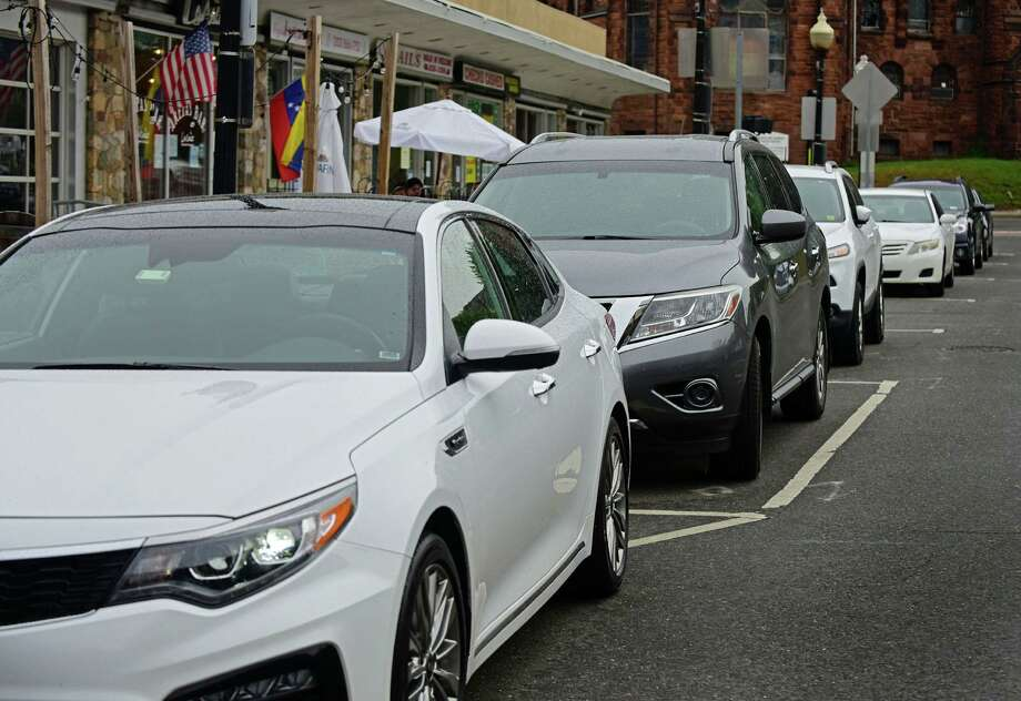 Cars parked along North Main Street Wednesday June 3, 2020, in Norwalk, Conn. Photo: Erik Trautmann / Hearst Connecticut Media / Norwalk Hour