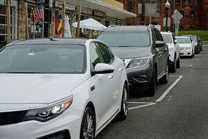 Cars parked along North Main Street Wednesday June 3, 2020, in Norwalk, Conn.