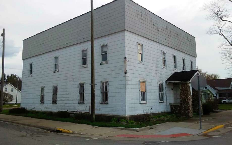 The village of Ubly is considering buying the former Masonic Hall on the corner of Washington (M-19) and Atwater to raze it to make it a clear-vision intersection. (Courtesy Photo)