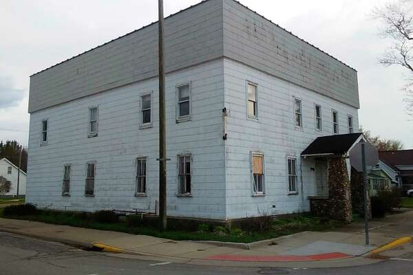The village of Ubly is considering buying the former Masonic Hall on the corner of Washington (M-19) and Atwater to raze it to make it a clear-vision intersection. (CourtesyPhoto)