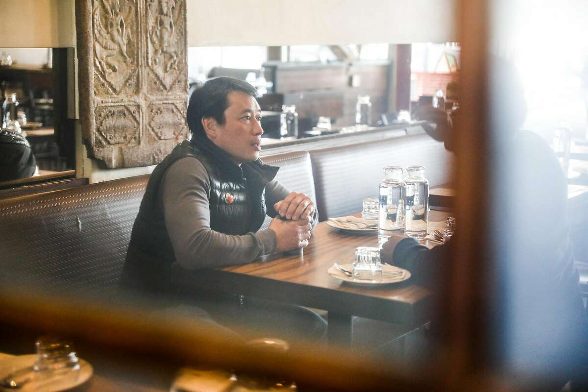 Desmond Tan (center), the owner of Burma Superstar sits for an interview at Burma Superstar in Oakland, California, on Thursday, Feb. 20, 2020.Tan�s newest restaurant Burma Bites will be focused on to-go and delivery.