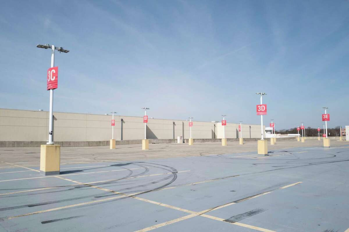 An empty parking lot is seen adjacent to the Westfield Mall in Annapolis, Md., on March 18. Department stores such as Macy's and Nordstrom are closed during the pandemic.