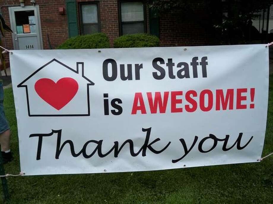 A sign outside the Burt Shelter Care Home celebrates its staff. The Alton facility currently has 21 residents.