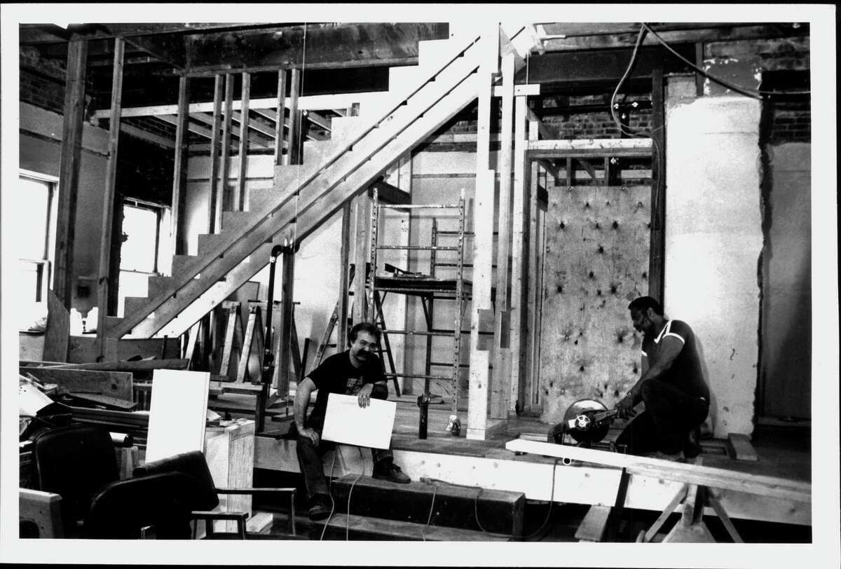 Richard Chesser, Thomas Lacy at Steamer No. 10 Theatre, Albany. Richard A. Chesser, executive director, left, and Thomas Lacy, plumber, sit in the old Engine 10 building that housed the Pine Hills Fire Station that is being rebuilt into the Steamer No. 10 Theatre. 1123 Madison Ave. June 05, 1990 (Paul Kniskern/Times Union Archive)