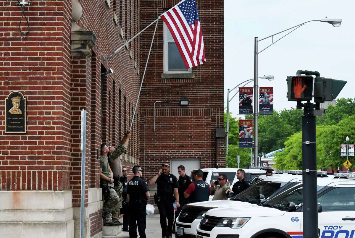 Troy police officers are seen outside the station on Wednesday, June 3, 2020, on Sixth Avenue in Troy, N.Y. The department is preparing ahead of a planned Sunday protest against police brutality. (Will Waldron/Times Union)