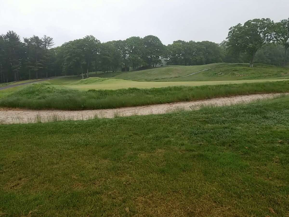 The 18th green at the Yale Golf Course. The course will finally open on Monday after being closed all year.