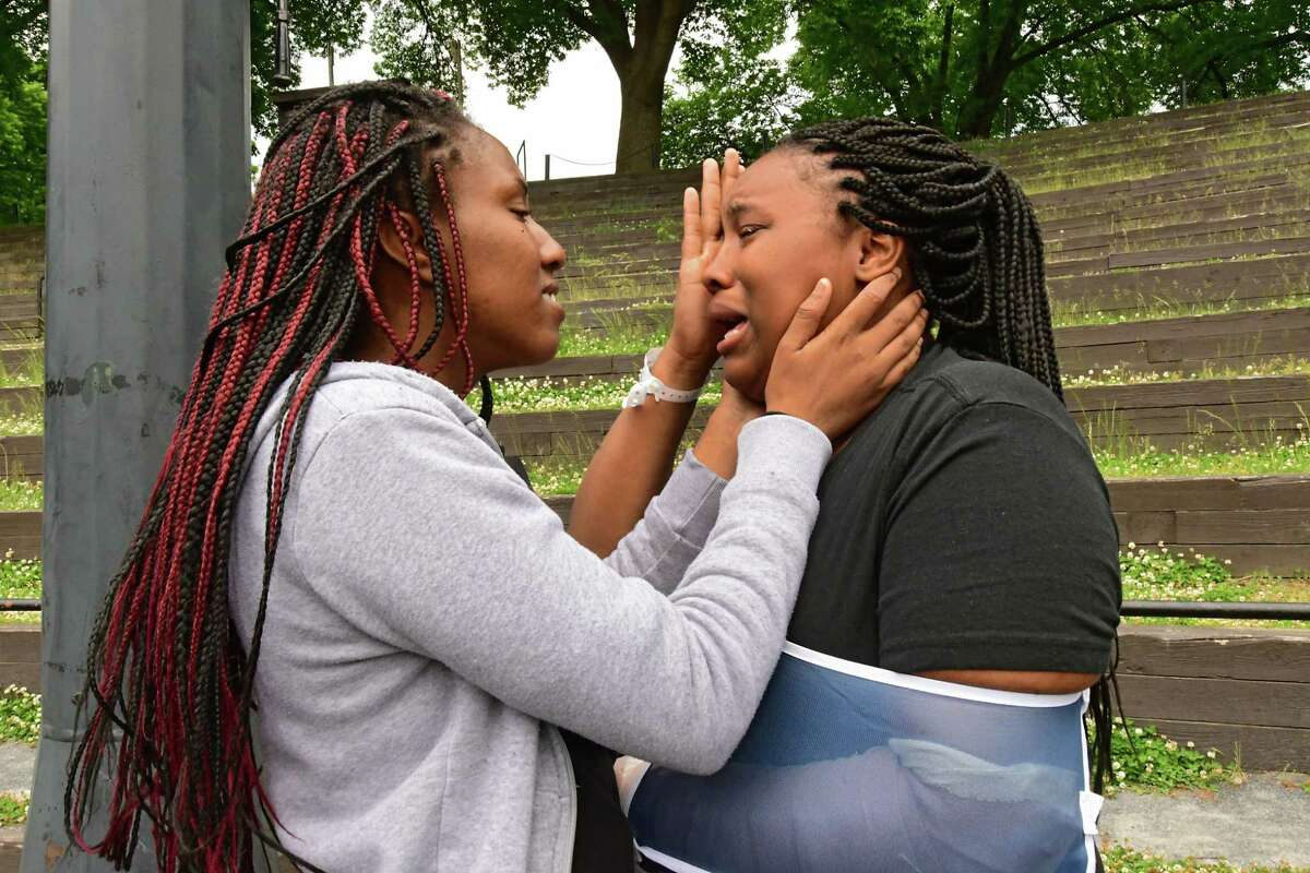 Ashley Turner of Albany, left, consoles her niece Desiree Shuman of Albany as protesters who are opposed to police brutality against black people rally in Washington Park on Wednesday, June 3, 2020 in Albany, N.Y. Desiree broke down while telling her story from the day before when the police broke her arm and tased her boyfriend Kimani Addison. (Lori Van Buren/Times Union)