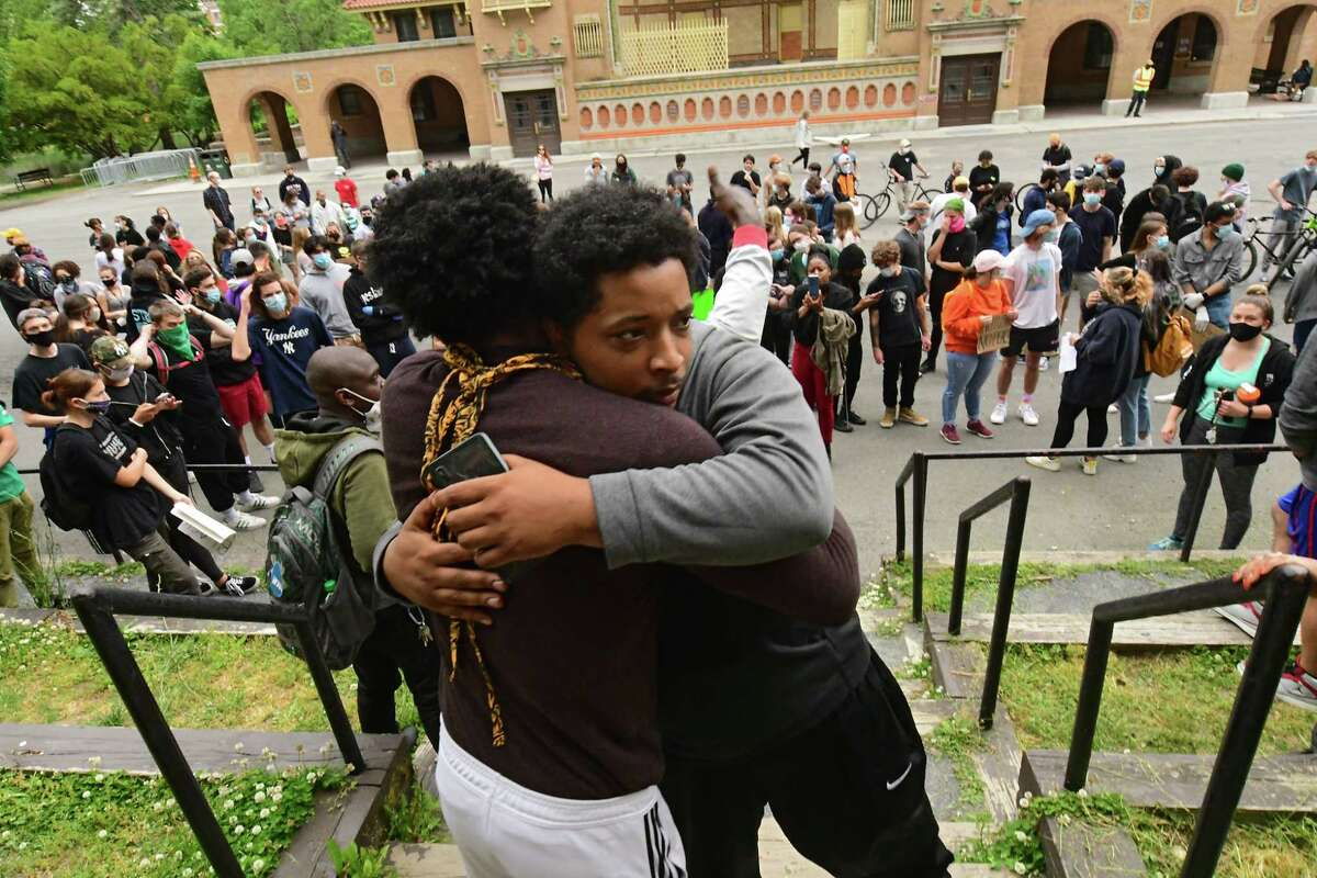 Lukee Forbes of Albany, left, hugs Kimani Addison of Albany as protesters who are opposed to police brutality against black people rally in Washington Park on Wednesday, June 3, 2020 in Albany, N.Y. Kimani had just pulled up to the rally and announced that the charges against him were dropped by the police. Yesterday he got tased and arrested by the police and his girlfriend's arm was fractured. The protesters marched through neighborhoods to bring social justice. (Lori Van Buren/Times Union)