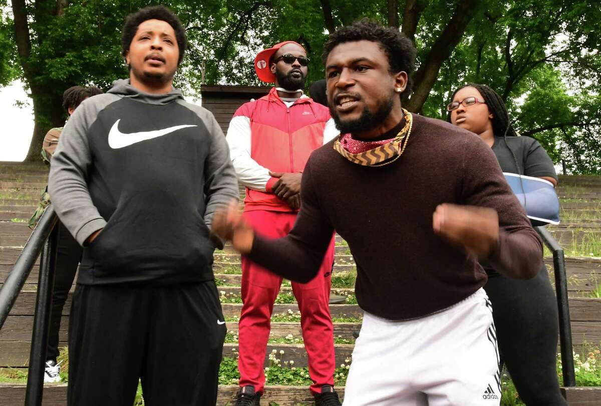 Lukee Forbes of Albany, right, speaks as protesters who are opposed to police brutality against black people rally in Washington Park on Wednesday, June 3, 2020 in Albany, N.Y. The protesters marched through neighborhoods to bring social justice. Kimani Addison of Albany is seen at left. (Lori Van Buren/Times Union)