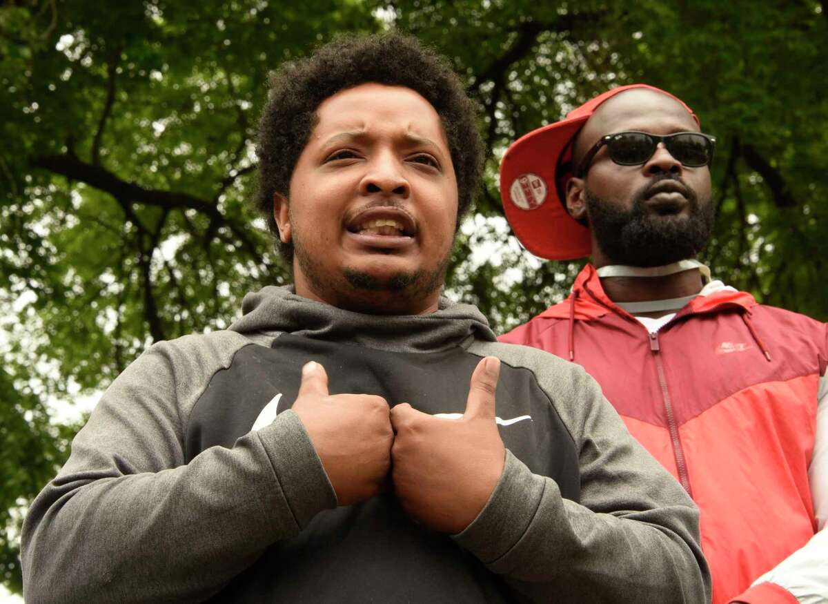Kimani Addison of Albany speaks about his experience as protesters who are opposed to police brutality against black people rally in Washington Park on Wednesday, June 3, 2020 in Albany, N.Y. Kimani had just pulled up to the rally and announced that the charges against him were dropped by the police. Yesterday he got tased and arrested by the police and his girlfriend's arm was fractured. The protesters marched through neighborhoods to bring social justice. (Lori Van Buren/Times Union)