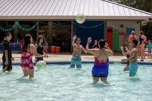 Officials with The Woodlands Township closed the recreation center at Bear Branch Park on Monday, June 29, after it was discovered that an employee had tested positive for the COVID-19 novel coronavirus. The facility will remain closed on Tuesday, June 30, and no opening date has been determined. The Sunny Days childcare camp will be closed until July 6. In  a press release , officials stated the facility was going to be thoroughly cleaned and disinfected and it would be reopened when appropriate. In this archive photograph, swimmers form a circle to bounce a beach ball back and forth to each other Thursday, July 4, 2019 at Bear Branch Pool in The Woodlands.