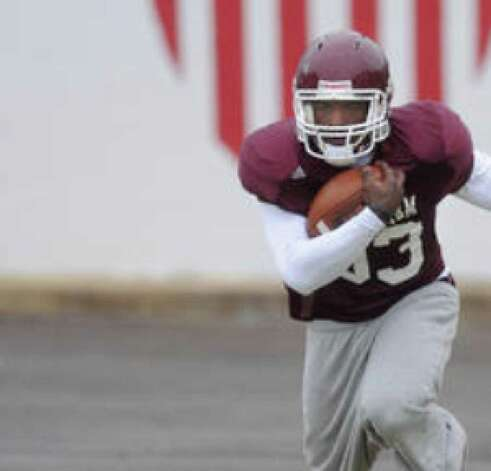 Christine Michael, shown practicing for the Independence Bowl, leads Texas A&M with 767 yards rushing.