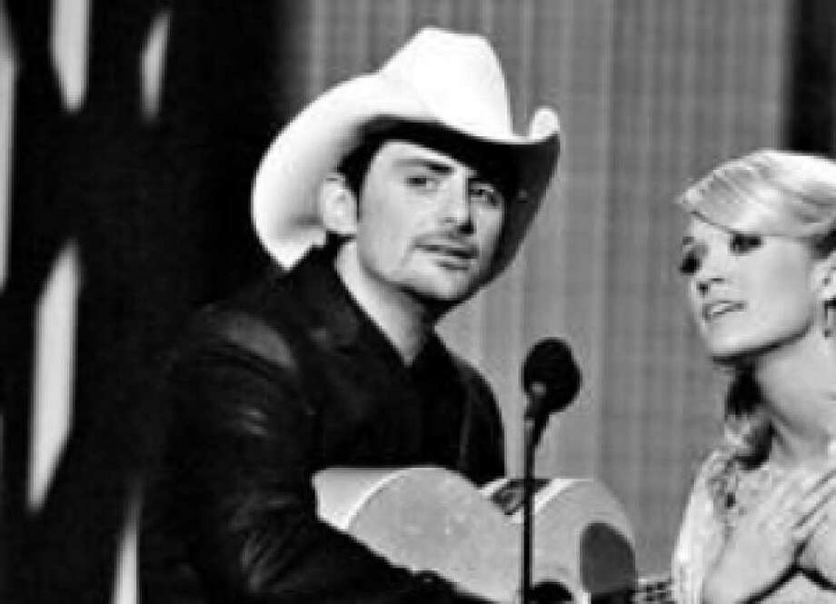 Brad Paisley and Carrie Underwood perform at the Country Music Association Awards in November. He was named male vocalist of the year.