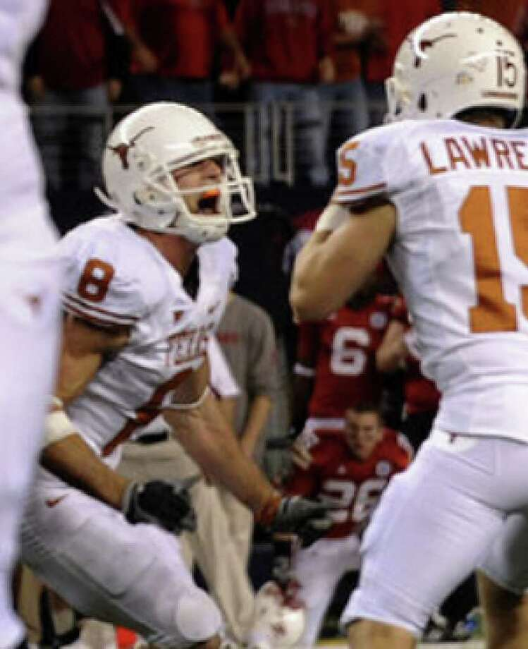 Texas kicker Hunter Lawrence and holder Jordan Shipley celebrate after Lawrence kicked the winning field goal in the final second of the Big 12 championship game against Nebraska. It was the first game-winner of Lawrence's career.
