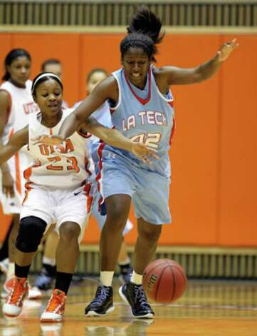 UTSA guard Whitney York (left) scrambles for the ball against Louisiana Tech forward Shanavia Dowdell.